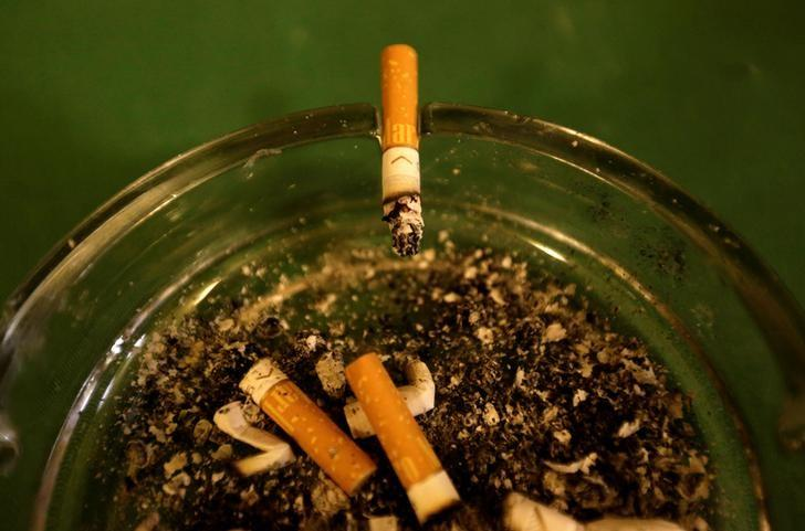 FILE PHOTO - A cigarette burns in an ashtray at a pub in Prague